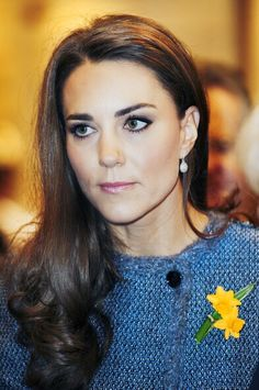 01.03.2012 Kate wears blue tweed Missoni coat for tea with The Queen & Camilla at Fortnum & Mason