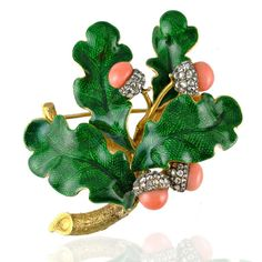 Antique enamel and gem-set oak leaf spray brooch, the green enamel leaves embellished with four coral bead acorns with rose-cut diamond caps moutend in all gold, in fitted case by Harvey and Gore.
