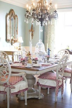 Ordinaire French Country Dining Room Ideas With Crystal Chandelier Over Wooden Table  And White Chair With Pink Cushions And Ornate Mirror And Sconce In The Wall  ...