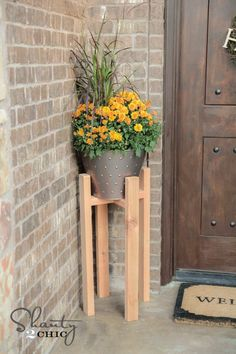 Free Woodworking Plans to build a simple DIY Plant Stand by Shanty-2-Chic.com!