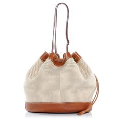 HERMES Crinoline and Natural Barenia Market Bag.   This stylish shoulder bag is crafted of finely woven crinoline pony hair and cotton blend.