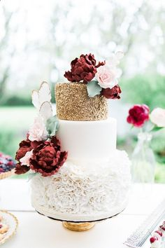 32 Romantic Floral Wedding Cakes to Show Your Baker - white fondant ruffle texture, marsala, gold, and rose quartz