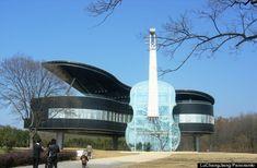 Piano and Violin house in China. You access the living area (piano) via escalators in the violin.