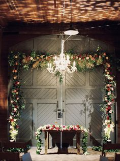 evening ceremony with a chandelier | Melanie Gabrielle
