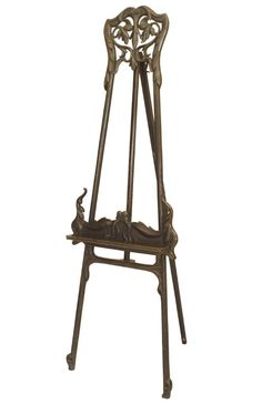 Art Nouveau (possibly Hungarian) green painted easel stand with a carved and filigree floral pediment.