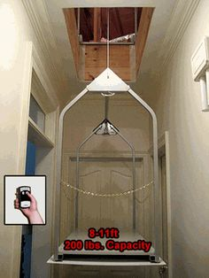 Wireless Remote Attic Lift Now this would make my life (and everyone else around here) MUCH easier...