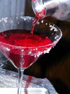 """Raspberry Martini    hint: do a slow pour and count 1 & 2 & 3 &. That equals a shot. It saves a bartender time so they can make drinks faster! So add one shot of of Raspberry Pucker, one shot of Vodka, and a """"dash"""" (about 3/4 of a shot) of Cranberry juice"""