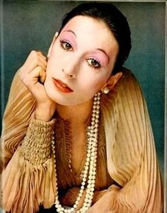 Angelica Huston 1972. Love the blouse, but Huston's harlequin face not so much...