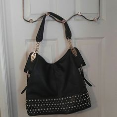 Gently used LaTique black purse. Excellent condition, gently used black purse with gold and diamond looking studs on bottom front none missing, gold hardware on hooks and sides. LaTique Bags Shoulder Bags