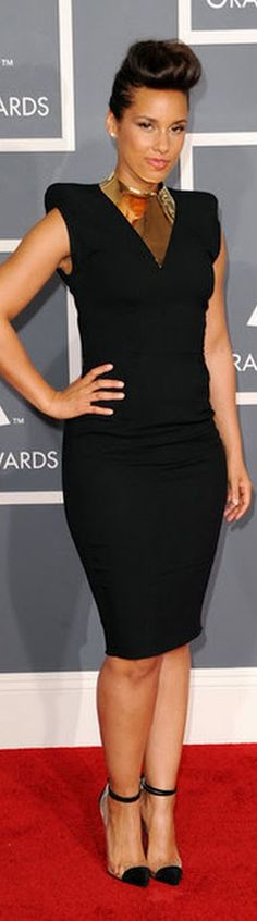Red Carpet Fashion dress - elegance in a black Alexandre Vauthier dress with statement gold neckpiece