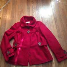 Red winter coat!! This is a really nice warm coat! It looks great dressed up or down! It has no holes or stains. It has all of its buttons. It comes from a smoke free environment. I ship Monday-Friday. I don't do holds or trade. If you ask me to trade you will be blocked. Please do not negotiate the price in the comments! Use the offer button or be ignored! This is not included in the bundle deals!! Hydraulic Jackets & Coats