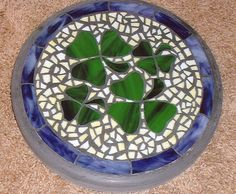 "4 is a Charm - Handmade Stained Glass and Concrete Stepping Stone - 14"" Round on Etsy, $90.00"