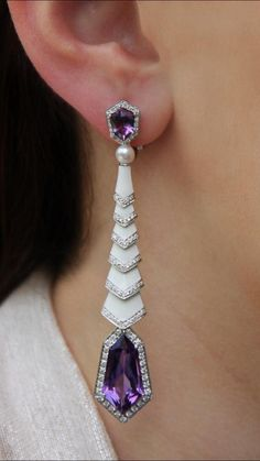 """'Great Gatsby"""" Amethyst and white Enamel Earrings. Faceted Amethysts set in drop-style earrings by Genevan jeweller AVAKIAN . Tapered white Enamel lozenges form the body of the earrings enhanced with Diamonds set in white Gold. Purple Jewelry, Amethyst Jewelry, Amethyst Earrings, Enamel Jewelry, Rose Gold Earrings, Antique Jewelry, Diamond Earrings, Vintage Jewelry, Bling Bling"""