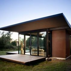 False Bay Writer\'s Cabin: Location: San Juan Island, Washington, USA Year of Construction: 2009 Architects: Olson Kundig Architects A glass box with Slatted facade panels that can be lowered or raised for sunlight protection.