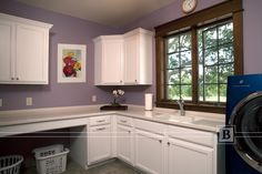 Laundry room cabinetry  in white finish.