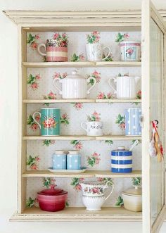 Wallpaper backed cabinet in the kitchen - I love those greengate dk salt and pepper shakers!