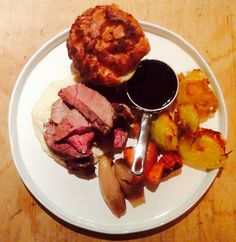 Sunday roast of topside of beef. Served with a horseradish & cauliflower purée; crispy Rosemary and beef dripping roast potatoes; shallots & carrots glazed in butter, stock, vermouth, thyme & star anise; Yorkshire pudding & jus.