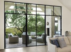 Black steel windows and doors. Black steel windows and doors to patio. Gorgeous floor-to-ceiling black steel windows and doors to patio. Black steel windows and doors Ryan Street & Associates. Door Design Interior, Window Design, Patio Design, House Design, Houses Architecture, Steel Doors And Windows, Black Windows, French Doors Patio, Modern Patio Doors