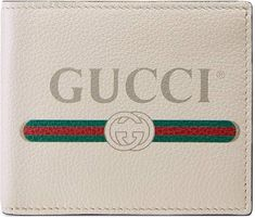 a95c7485760 Shop the Gucci Print leather bi-fold wallet by Gucci. Inspired by vintage  prints from the eighties