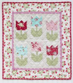 I was going through my computer and found these gorgeous project photos of my Tiny Tulips quilt pattern made by my friend, Kristin Esser. Kristin made this quilt for my Spring 2017 quilt market boo… Baby Girl Quilts, Girls Quilts, Small Quilts, Mini Quilts, Strip Quilts, Rag Quilt, Quilt Blocks, Granny Square Quilt, Flower Quilts