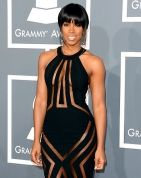 "Kelly Rowland's dress may have ""defied"" the newly implemented dress code at the Grammys, but you can't deny that she looked absolutely STUNNING in this Georges Chakra couture dress last night #Style"