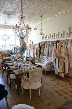 a wall of vintage aprons hanging on the wall of my bakery. (Rachel Ashwell Shabby Chic store)