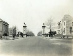 Delmar Boulevard west from Trinity Avenue showing the University City Lion Gates. (1930) Missouri History Museum