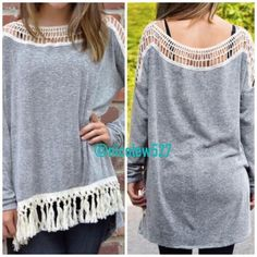 Grey Tassel Top Fun and flirty! Add style to your new favorite shirt with a fringe hem and detailing along the neckline. Available in small, medium, and large. The measurements are shown in the third picture. Boutique Tops Tees - Long Sleeve