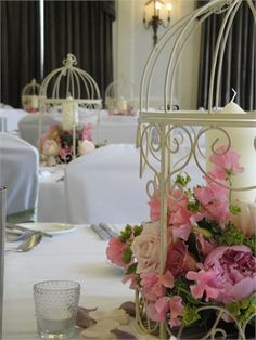 Vintage Birdcage with flowers and church pillar candle - table centre