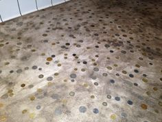 Foreign coins in the floor.