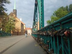 This is a town in Russia called Vyborg, when they are getting married the bride and groom come to the bridge and put their padlock on it, then throw the key away to symbolize their commitment and love for each other.