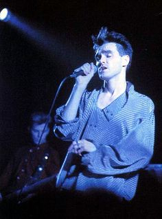 Morrissey and Andy Rourke (in the backgorund) on stage with The Smiths at Royal Albert Hall, London, England on April 1985 -- photo by Stephen Wright. Moz Morrissey, The Smiths Morrissey, Rock Roll, Andy Rourke, Johnny Marr, Aesthetic People, 90s Aesthetic, Robert Smith, Cinema