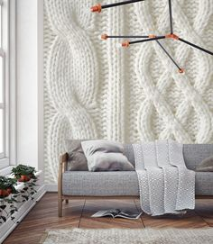 The latest big interiors trend 'Hygge', says we should all be indulging in the cosiest of home décor,to give our homes (and overselves) some extra love this Winter. This charming Knit mural collection by Murals Wallpaper celebrates the comfort and sentimentality of knitted piecesby bringing the
