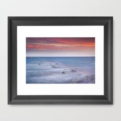 Pink sunset at the mediterranean Framed Art Print by Guido Montañés - $37.00