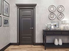 A spacious and luxurious cloak room is connected to the bedroom with a wide doorway. The Royal doors very successfully emphasize this portal and add rigor and nobility. For the decoration of the walls, decorative plaster is chosen, which echoes with the silver patina of the door. Oak parquet is perfectly combined with black color. Such a door will serve as a real decoration of the interior. Choose your Royal door: https://unitedporte.us/collections/royal