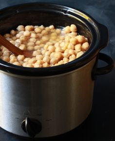Alton Brown's Slow Cooker Chickpeas: Throw a pound of chickpeas in a slow cooker (no soaking required) and  just like that, you can replace four cans.