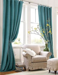 Turquoise curtains make a simple and elegant focal point against white.