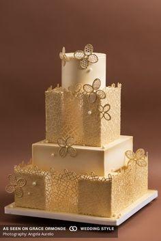 gold lace design on a square wedding cake  #GOWS #platinumlist #weddingplanning #weddingideas #weddinginspiration #bridal #brides #luxuryweddings #graceormonde #weddingstyle #luxuryweddings #couture #weddingcakes #desert #cakes #goldandwhite #gold&white #gold #white