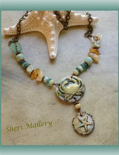 By Sheri Mallery. Been to the beach lately? My porcelain pendants with some fun stuff.