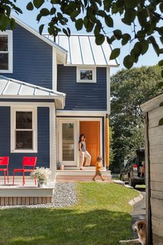 Navy house, orange door. A navy house with white trim couldn't get any more classic — but the juicy orange door adds personal flair. A brigh...