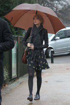Taylor Swift black leather jacket black skirt pattern black stockings umbrella