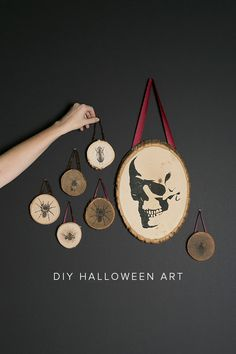 DIY Halloween transfer wood plaques perfect for home decor complete with skulls and insects.