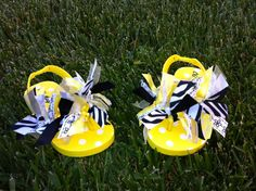 Bumble bee yellow and black baby and toddler girls ribbon tie flip flops, sandals, baby shoes, beach shoes on Etsy, $9.95