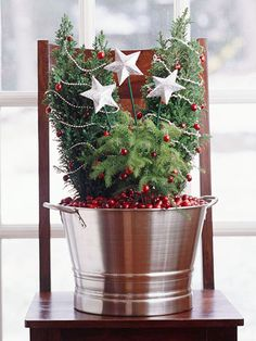 "Christmas | Position tiny trees in a bucket, then fill with cranberries. Bend bits of wire as hooks for cranberry ""ornaments"" on the trees."
