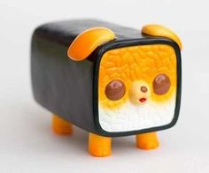 Sushi Inu figure by Paul Shih. Front view.