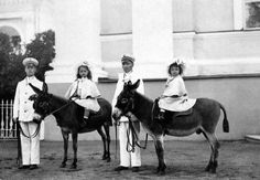 Olga & Tatiana Riding Donkeys