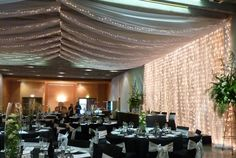 how to disguise a drop ceiling wedding | Curtain lights | Fairy Lights | Ceiling draping | Wedding lights