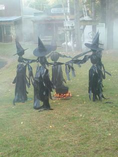 Halloween outdoor decor: Witch circle with lighted cauldron