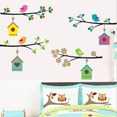 Muursticker takken met kleurrijke vogelhuisjes
