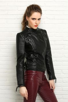 Attractive model in fitted ribbed black leather jacket and maroon leather pants outfit